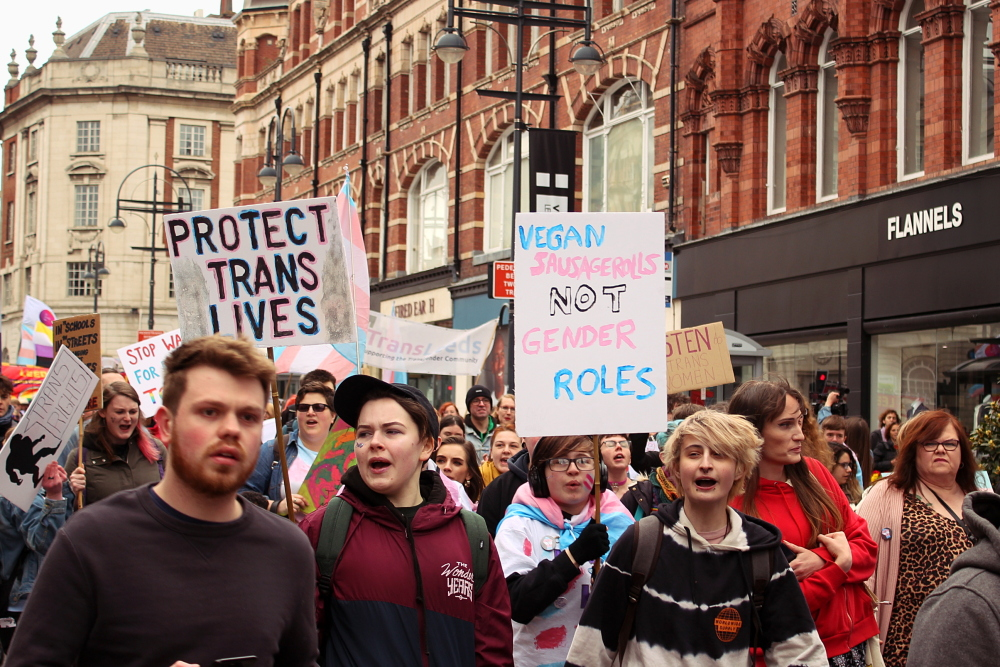 Trans Pride march on Vicar Lane in Leeds. Placards say